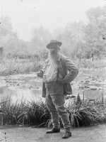 Claude Monet in front of his beloved water lilies in the early 20th century